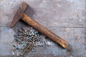 Old hammer and nails — Stock Photo