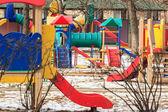 Outdoor kids playground in winter city — Stock Photo