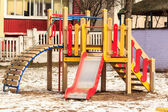 Wooden outdoor playground in winter — Stock Photo