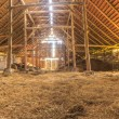 Panorama interior of old farm barn with straw — Stock Photo