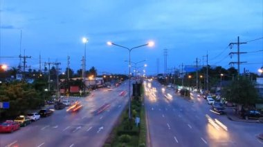 Highway traffic driving multiple lane, time lapse at twilight — Stockvideo