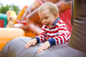 Four-year-old kid playing on a trampoline outdoor — Foto Stock