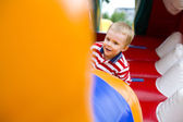 Four-year-old kid playing on a trampoline — Stockfoto