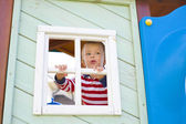 Four-year-old boy who is looking out in a window of a children's — Stok fotoğraf