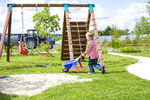 Four-year-old boy playing at a playground with sand — Foto Stock