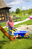Four-year-old boy playing at a playground with sand — Stock Photo