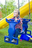 Four-year-old child riding a swing — Стоковое фото