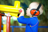 Boy shooting from a toy gun — Стоковое фото