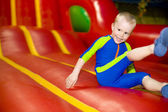 The four-year-old child jumping on a trampoline — Stok fotoğraf