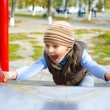 Stock Photo: Active four-year-old boy playing at playground
