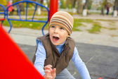 Portrait of the four-year-old child playing at a playground — Stok fotoğraf