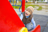 Portrait of the four-year-old child playing at a playground — Стоковое фото