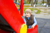 Portrait of the four-year-old child playing at a playground — ストック写真