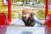 Active four-year-old boy playing at a playground — Stok fotoğraf