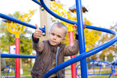 Attractive four-year-old boy at a playground — Stok fotoğraf