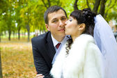 Bride kisses gently groom — Stock Photo