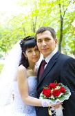 Portrait of romantic newlyweds — Stock Photo