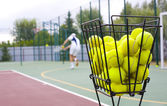 Basket for tennis balls — Stock Photo