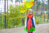 Portrait of five-year-old girl with balloons — Stock fotografie