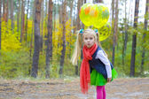 Portrait of five-year-old girl with balloons — Stock Photo