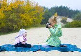 Five-year-old photographer with small model — Stock Photo