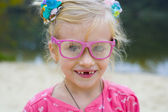 Funny portrait of emotional girl in pink glasses — Stock Photo