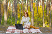 Beautiful young girl with the laptop — Stock Photo