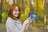 Portrait of beautiful girl with the smartphone — Stock Photo