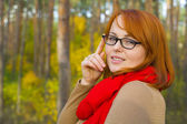 Portrait of beautiful red-haired girl in glasses — Stock Photo