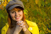 Attractive red-haired girl in the autumn wood — Stock Photo