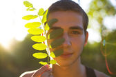 Portrait of a young man backlit — Stock Photo