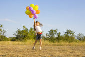 Funny little girl with balloons, bouncing — 图库照片
