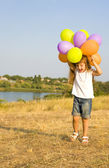 Four-year girl with balloons — Stock Photo