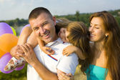 Young happy family — Stock Photo