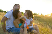 Beautiful young family of three — Stockfoto