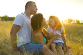 Beautiful young family of three — Stock fotografie