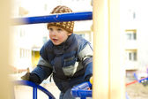 Boy plays at a playground — Stock Photo
