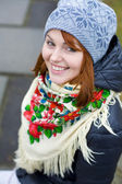 Girl in a bright Ukrainian scarf — Stock Photo