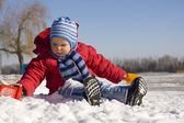 The little boy plays snow — Stock Photo