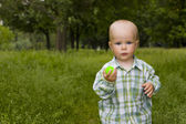 Kid in grass — Stock Photo
