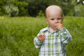 Kid in grass — Stock Photo