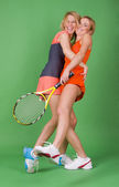 Girls-tennis-players in studio on a green background — Stock Photo