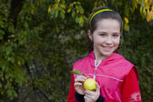 Portrait of the girl with plaits apple — Stock Photo