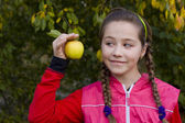 Portrait of the girl with plaits and an apple — Stock Photo