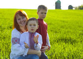 Happy mother with two sons outdoors — Stock Photo
