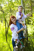 Mother with child in the Ukrainian national clothes — Stock Photo