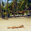 Girl sleeping on the beach — Stock Photo #41389199