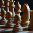 Chess pieces (focus on back rank) — Stock Photo