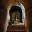The ancient tunnel and statue buddha — Stock Photo