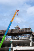 Construction site with crane and workers — Foto de Stock